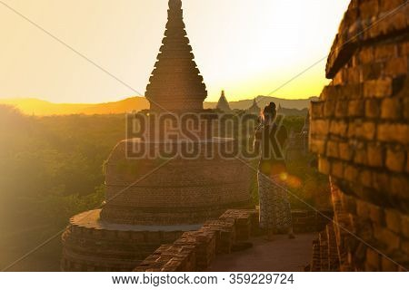 Bagan Myanmar Young Woman Photographs Beautiful Stupas At Sunset