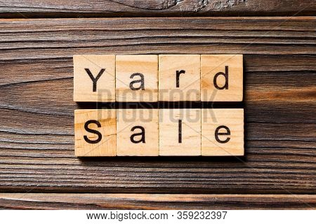 Yard Sale Word Written On Wood Block. Yard Sale Text On Wooden Table For Your Desing, Top View Conce