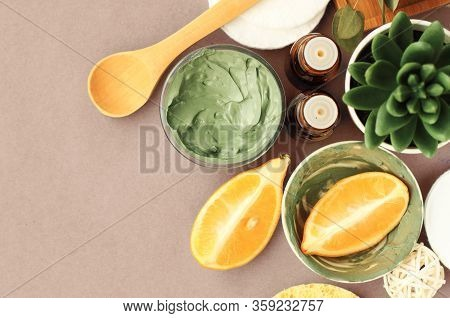 Homemade Skin Care With Green Cosmetic Bentonite Clay For Facial Mask With Lemon Essential Oil, Top