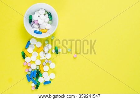 Tablets Are Scattered On The Table, Dosage For The Patient. Top Views With Clear Space