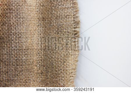 Hessian Brown Swatch Isolated On White Background. Burlap Sackcloth Material, Beige Color Detail Of