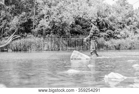 Teach Man To Fish. Fishing Outdoor Sport. Fisherman Catching Fish. Fishing Hobby. Calm And Tranquil.
