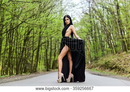 Sexy Girl Elegant Dress High Heels At Road. Beauty And Fashion. Woman In Black Dress. Elegant Lady.