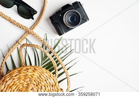 Flat Lay Stylish Traveler Accessories With Tropical Palm Leaf Branches On White Background. Top View