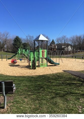 Empty Playground On A Sunny Spring Day During Covid-19 Lockdown
