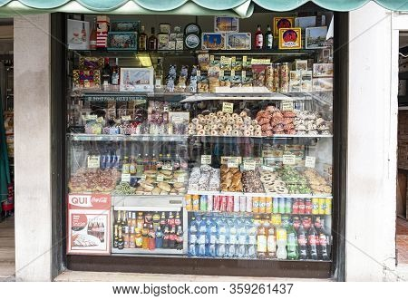 Venice, Italy - June 29 2017: Historic Buildings In Venice, A Shop Window With Sweets And Cookies In