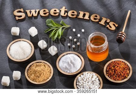 Top View Of Natural Sweeteners - Phrase Sweetener In Wooden Letters
