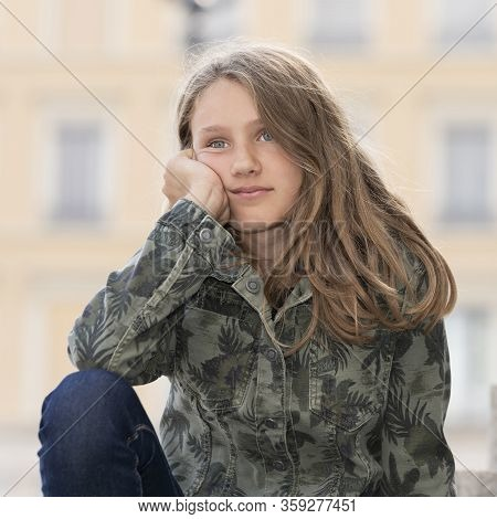 Horizontal Portrait Of Young Girl Outdoor, France, Europe
