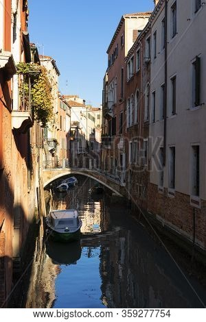 Vertical View Of Smal Canal In Venice, Italy