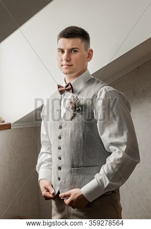 Handsome Groom Waiting For The Bride On The Background In Hotel. Rich Groom On The Wedding Day. Eleg