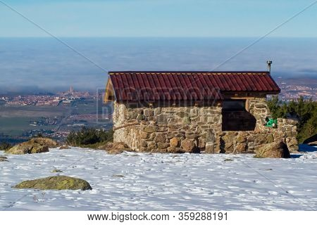 Horizontal Landscape Of A Refuge For Climbers A Cold Snowy Day In Winter, In Which There Is Still Sn