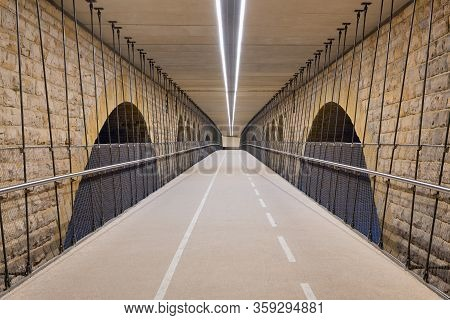 Illuminated Cycle Track Below Pont Adolphe Bridge In Luxembourg City