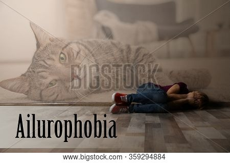 Scared Little Girl Lying On Floor Indoors. Suffering From Ailurophobia (irrational Fear Of Cats)