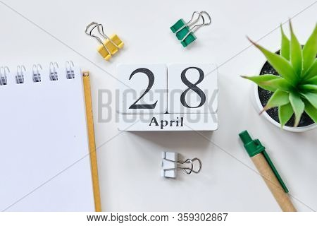 Date On White Wooden Cubes - The Twenty Eighth, 28, April On A White Table. Top View. Close Up.