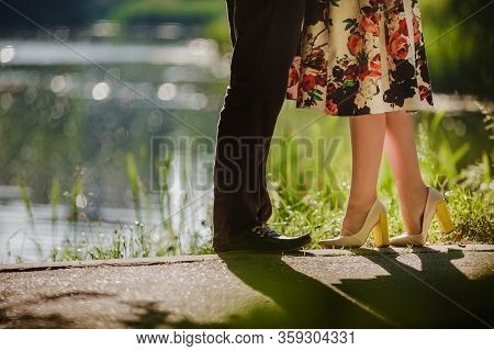 Couple Kissing Outdoors - Lovers On A Romantic Date At Sunset, Girls Stands On Tiptoe To Kiss Her Ma