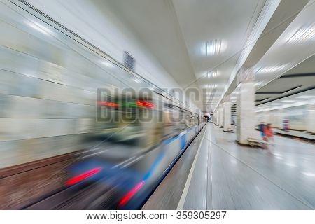 Blurrred Image Of The Night Underground Station.