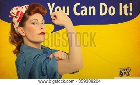 Self-confident Middle Aged Woman With A Clenched Fist Rolling Up Her Sleeve, Text Space, Tribute To