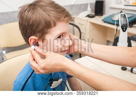 Boy In Hearing Clinic. Impedance Audiometry. Methods For Testing The Middle Ear In A Child