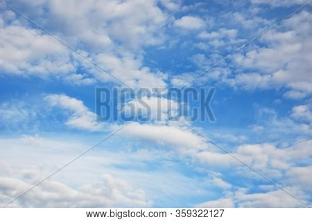 Airy Skyscape Of Light Blue Sky With Delicate White Ethereal Clouds On Nice Sunny Day.