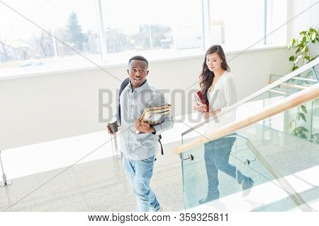 African student and asian student together as a couple in school