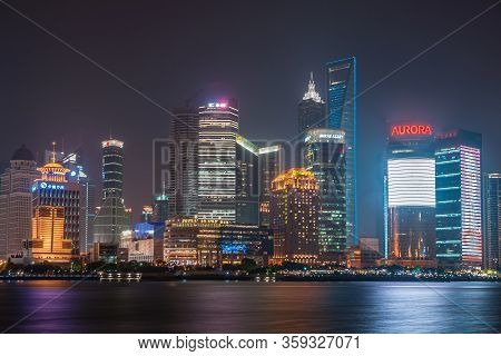 Shanghai, Pudong, Lujiazui, China - May 4, 2010: Night Skyline Of Colorfully Lighted Skyscrapers Aro