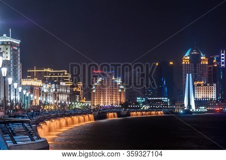 Shanghai, China - May 4, 2010: Night  Photo Of The Bund Boardwalk Along Huangpu River Ending At Waib