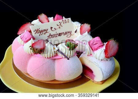 Gorgeous And Delectable Strawberry Jelly Vanilla Mousse Anniversary Cake On Black Background