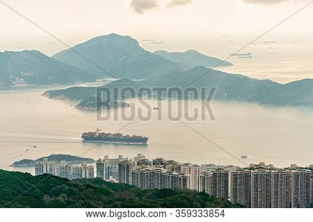 Lamma Island Viewed From Victoria Peak On Hong Kong Island In Hong Kong. Container Vessel Transports