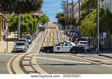 San Francisco, California, Usa- 07 June 2015: Police Car On The Steep Mason Street. Cars Parked Alon