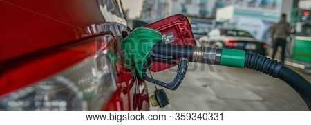 Fuel Filling At Gas Station, Red Car, Panorama Or Banner Picture