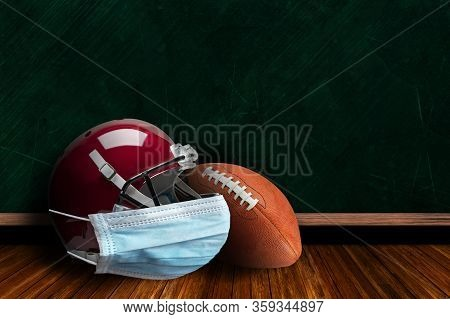 Football Helmet Wearing Surgical Mask On A Background Chalk Board With Copy Space For Text. Concept