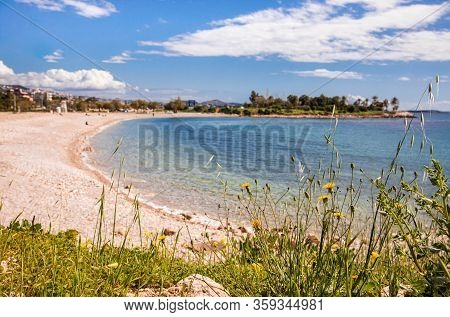 Beautiful Spring Seascape With Calm Sea, Pebbles Beach, Blue Sky Of Suburb In South Athens Located I