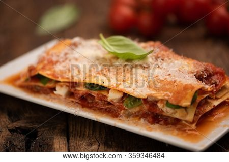 Italian Lasagne With Meat, Tomatoes, Cheese Sauce And Pasta