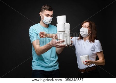 Woman Grabbing Toilet Paper From Man. Woman Grabbing Toilet Paper From A Young Man