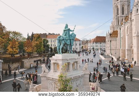 Budapest, Hungary - Nov 6, 2019: St. Stephen Equestrian Statue From Behind. Tourists Sightseeing On