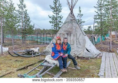 Lovozero, Russia - September 25, 2016,man And Woman, Sami In National Dress, Sami Village On The Kol