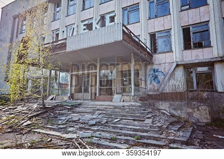 Pripyat, Ukraine - April 25 2019: Rusty Sign Of Radioactivity On A Building In Abandoned City Of Pri