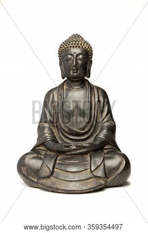 A Small Replica Statue Of The Buddha Isolated On White