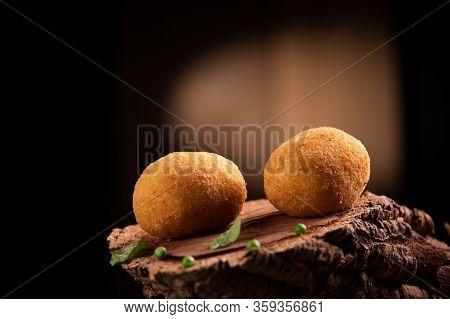 Arancini Rice Balls. Fried Rice Balls On Brown Wooden Background. Snack, Street Food