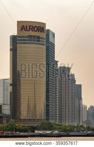 Shanghai, Pudong, Lujiazui, China - May 4, 2010: Closeup Of Golden Aurora Skyscraper And Others On S