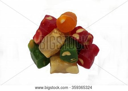 Mix Of Candied Fruit With A Variety Of Flavors: Orange, Cherry, Kiwi, Honey. Oriental Sweets On A Wh