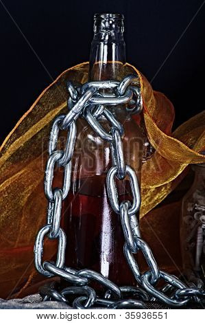 Still life with a bottleand a chain