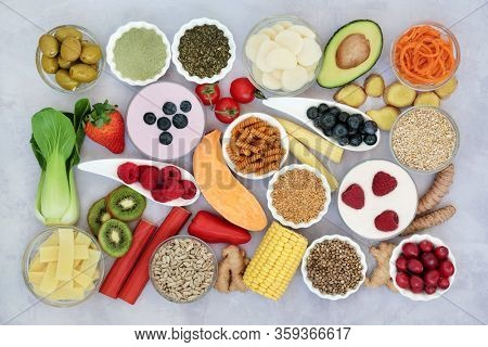 Super food to ease irritable bowel syndrome. Health foods high in antioxidants, protein, lycopenes, dietary fibre, vitamins, minerals, omega 3, smart carbs & anthocyanins. Flat lay.
