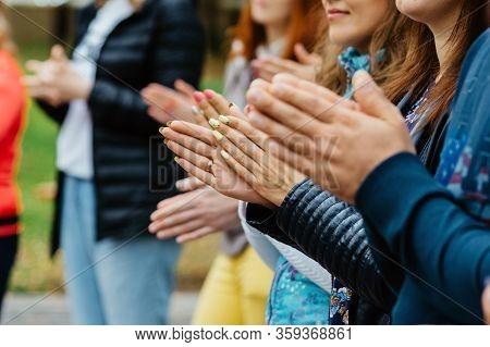 Women Clap Their Hands On Team Play