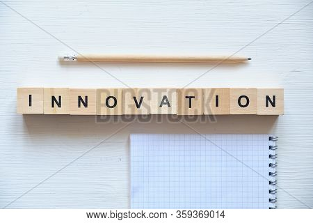 Modern Business Buzzword - Innovation. Top View On Wooden Table With Blocks. Top View. Close Up.