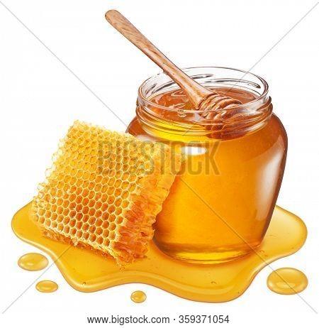 Glass pot of honey, honeycombs and sweet sticky honey puddle isolated on white background.