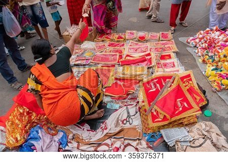 Kolkata, West Bengal, India - 15th April 2019 : Young Bengali Woman Selling Red Colour Seats With Au