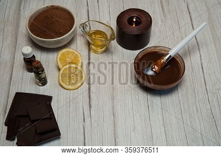 Natural Cosmetics. Spa Skin Care, Ingredients For Chocolate Wraps. Chocolate, Cocoa Powder, Lemon Ju