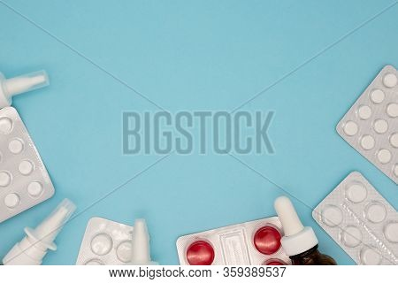 Pile Of Scattered Capsules On A Blue Background. Capsules Isolated White Capsule Pharmacy Bottle Pil