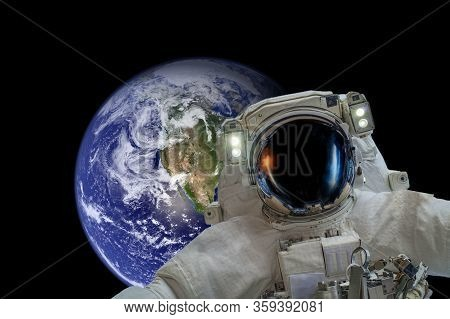 Space Exploration. Astronaut In Outer Space. Planet Earth From Space On A Dark Background. Elements